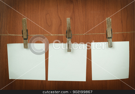 Memory note paper hanging on cord stock photo, white memory note paper hanging on cord on wooden background by Artush