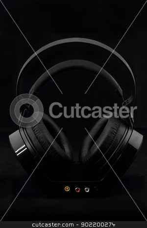 Headphones on black background stock photo, Black modern Headphones on a black background by Nneirda