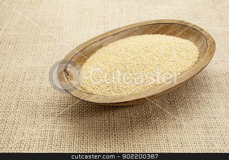 amaranth grain stock photo, amaranth grain in a rustic oval wood bowl on canvas background by Marek Uliasz