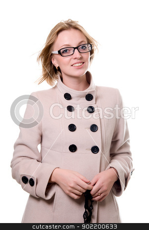 Portrait of a cheerful girl in a light coat stock photo, Portrait of a cheerful girl in a light coat. isolated on white  by Vadim
