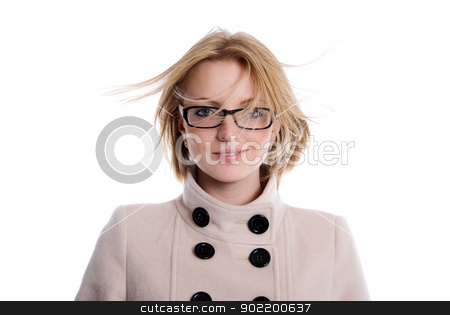 Portrait of a blonde in a coat with flowing hair stock photo, Portrait of a blonde in a coat with flowing hair. isolated over white background by Vadim