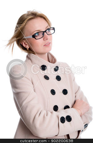 Girl in coat looking to the side stock photo, Girl in coat looking to the side. isolated over white background by Vadim