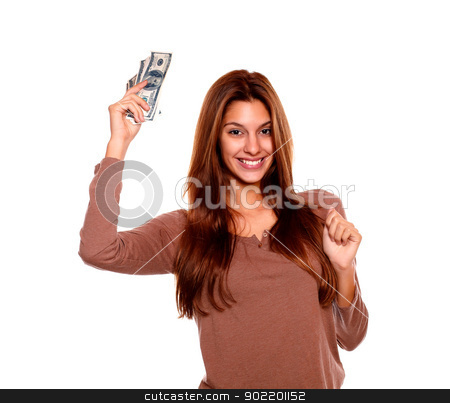 Happy young woman holding up cash money stock photo, Portrait of a happy young woman holding up cash money with long brown hair on white background by pablocalvog