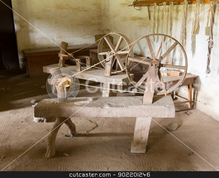 Old spinning wheels in spanish mission stock photo, Old spinning wheel made from timber and branches in La Purisima mission California by Steven Heap