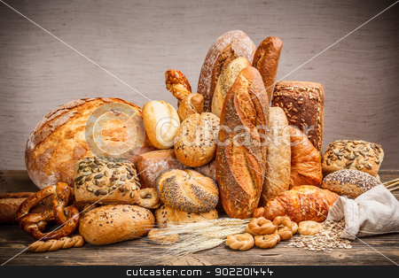 Bread stock photo, Assortment of different types of bread by Grafvision