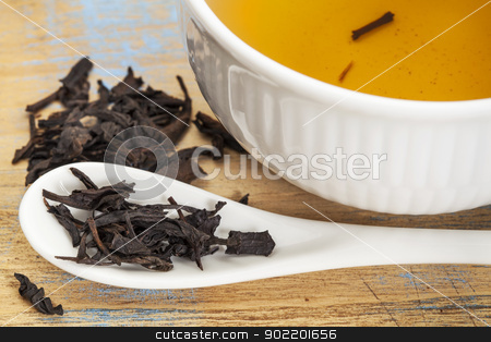 Se Chung Oolong tea stock photo, Se Chung Oolong tea - a white cup of drink and loose leaves on teaspoon by Marek Uliasz