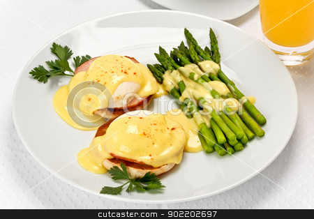 Eggs Benedict stock photo, Two poached eggs, and canadian bacon, on an english muffin topped with hollandaise sauce with green asparagus on the side on white plate. by Glenn Price