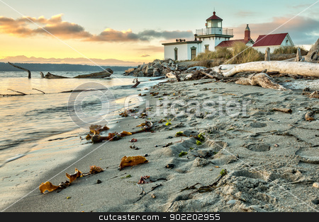 Sun set at West Point Lighthouse at Seattle Washington stock photo, Sun setting on the West Point Lighthouse  at Seattle, Washington by Gary Ives