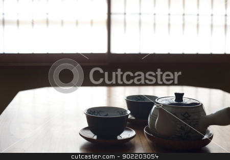 Japanease Tea set stock photo, A silhouette image of two japanese tea cups and a tea pot with a defocused paper screen window to the rear by Stephen Gibson