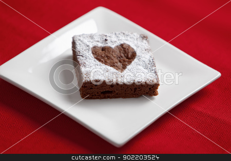 Chocolate Brownie stock photo, Chocolate brownie with powdered sugar heart. by Glenn Price
