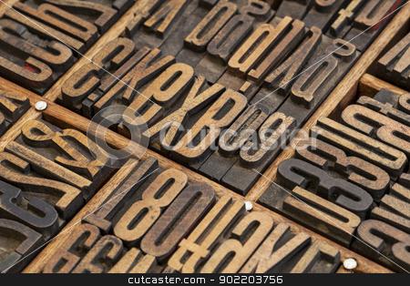 lettepress wood type blocks stock photo, vintage letterpress wood type blocks in a typesetter drawer by Marek Uliasz