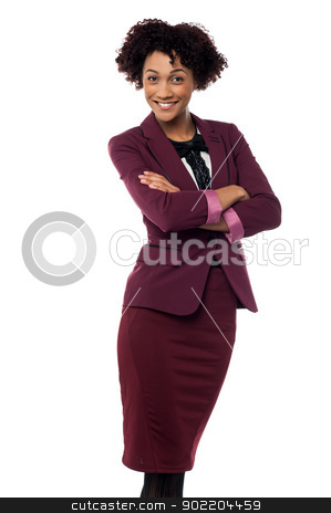 Ambitious female business executive stock photo, Confident business executive on white background posing with arms crossed. by Ishay Botbol   