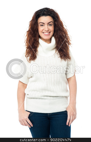 Portrait of charming girl in high neck sweater stock photo, Casual portrait of a fashionable young woman wearing high neck sweater. by Ishay Botbol