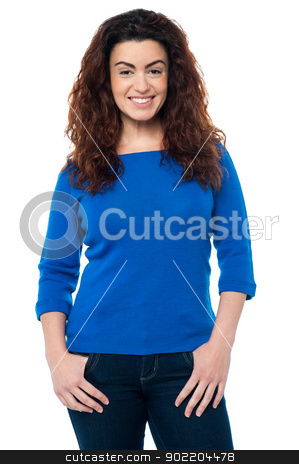 Pretty woman with long curly hair in casuals stock photo, Stylish caucasian woman in casual attire smiling at the camera, long curly hair. by Ishay Botbol