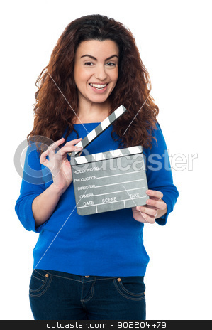 Cute woman in blue attire holding clapperboard stock photo, Charming woman posing with clapperboard in hands. All on white background. by Ishay Botbol