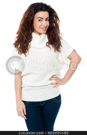 Trendy woman striking stylish pose stock photo, Pretty woman in casuals posing with hand on her waist. by Ishay Botbol