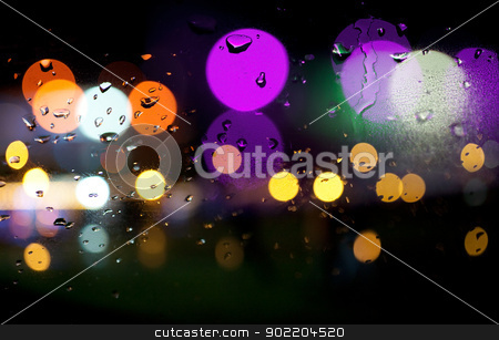 abstract city lights stock photo, abstract background of colored city lights by carloscastilla