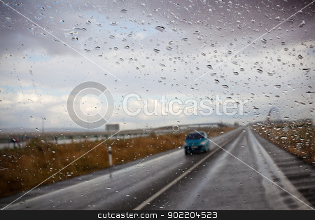 road and rain stock photo, Abstract image of car and road Through the window  by carloscastilla