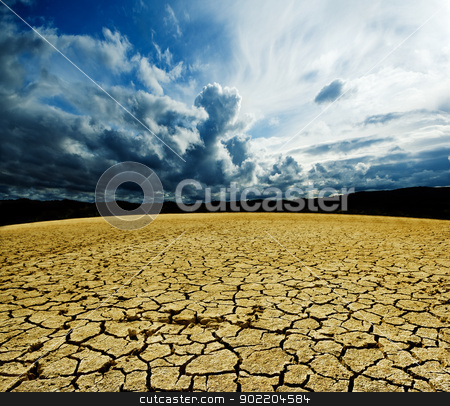 dry Landscape stock photo, Landscape with storm clouds and dry soil  by carloscastilla