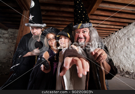 Mythical Family of Wizards stock photo, Father and children in mythical wizard costumes by Scott Griessel