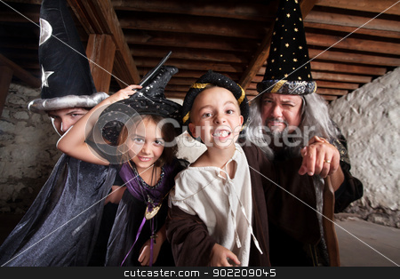 Family of Four Sorcerers stock photo, Happy family of sorcerers together indoors by Scott Griessel