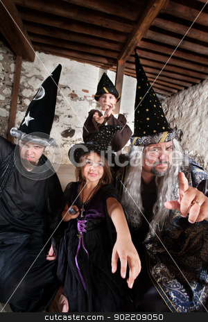 Sibling Wizards and Father stock photo, Sister and brother wizards casting spells with their father by Scott Griessel