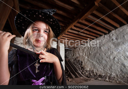 Excited Young Witch stock photo, Excited little girl dressed as witch and holding a wand by Scott Griessel