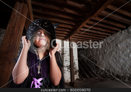 Bratty Little Child Witch stock photo, Young female witch pouting and pulling down her hat by Scott Griessel
