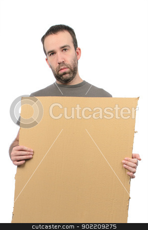 Poverty stock photo, A scruffy looking guy holding a cardboard sign, isolated on a white background. by Richard Nelson