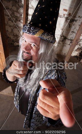 Smiling Wizard Pointing stock photo, One smiling bearded wizard pointing his fingers by Scott Griessel