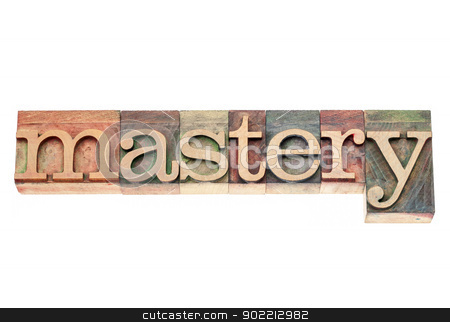 mastery word in wood  type stock photo, mastery  - isolated text in vintage letterpress wood type printing blocks by Marek Uliasz