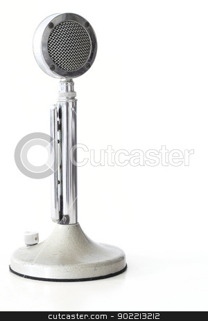 retro Microphone stock photo, retro Microphone on white table with its reflection by Vichaya Kiatying-Angsulee