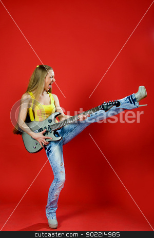 beautiful girl with a guitar screaming stock photo, beautiful girl in jeans with a guitar screaming by Alexbeast