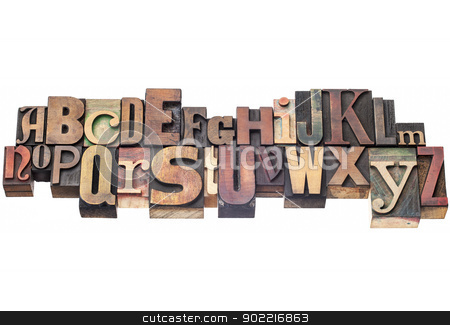 alphabet in wood type stock photo, English alphabet abstract in antique wood letterpress printing blocks of different sizes and styles, isolated on white by Marek Uliasz