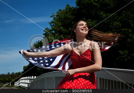 Woman American Flag stock photo, Young girl waving American flag outdoors by Stephanie Zieber