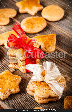 Christmas gingerbread stock photo, Stack of christmas gingerbread cookies tied with ribbon by Grafvision