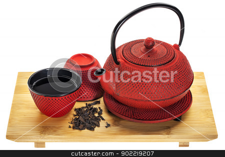 tetsubin and oolong tea stock photo, red hobnail tetsubin (traditional cast iron Japenese teapot) with a cup of oolong tea on a bamboo tray by Marek Uliasz