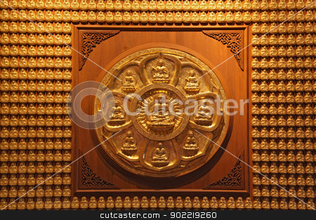 golden wheel of buddha on wall in dragon temple Thailand stock photo, golden wheel of buddha on wall in dragon temple Thailand by Vichaya Kiatying-Angsulee