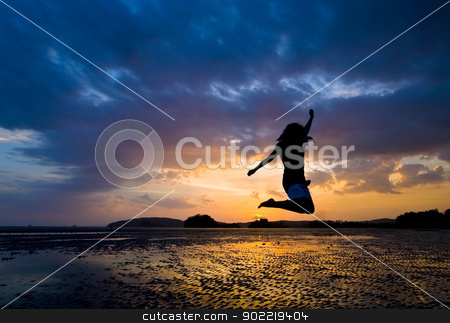 jumper stock photo, Funny time in dusk at Phranang Beach near Phuket Thailand by Vichaya Kiatying-Angsulee