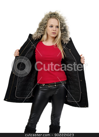 Blond woman showing blank red shirt stock photo, Young beautiful blond female opening her winter jacket to show the blank red t-shirt she is wearing. Ready for your design or artwork.  by © Ron Sumners