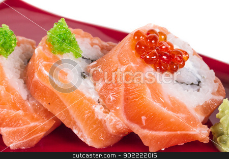 Japanese sushi traditional japanese food.Roll made of salmon, re stock photo, Japanese sushi traditional japanese food.Roll made of salmon, red cavair, roe and cream by Andrey Starostin