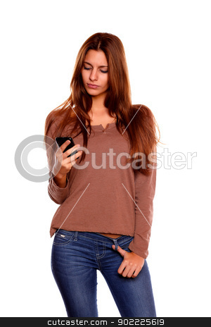 Young woman sending a message with her cellphone stock photo, Portrait of a young woman with long brown hair sending a message with her cellphone against white background by pablocalvog