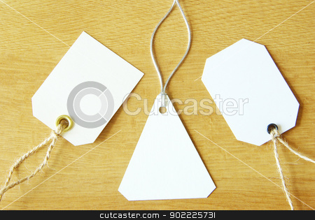 labels stock photo, Blank tag isolated on a wooden background by Vitaliy Pakhnyushchyy