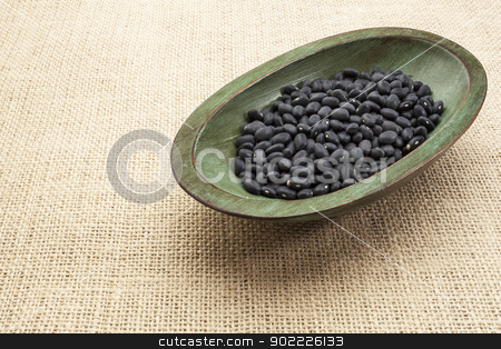 black turtle beans stock photo, black turtle beans in a rustic wood bowl against burlap canvas by Marek Uliasz
