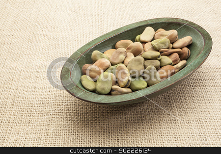 fava (broad) beans stock photo, fava (broad) beans  in a rustic wood bowl against burlap canvas by Marek Uliasz