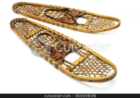 vintage bear paw snowshoes stock photo, vintage wooden bear paw snowshoes with leather binding on white by Marek Uliasz