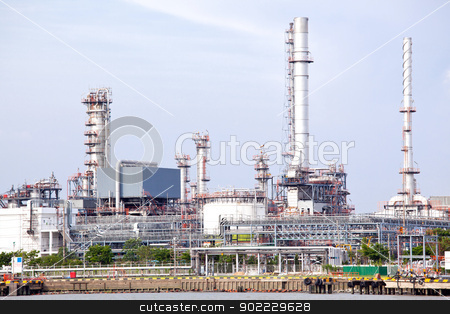 Oil refinery plant stock photo, Oil refinery plant along river by Vichaya Kiatying-Angsulee