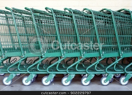 Shopping Carts stock photo, Green shopping carts together in a line up. by Henrik Lehnerer
