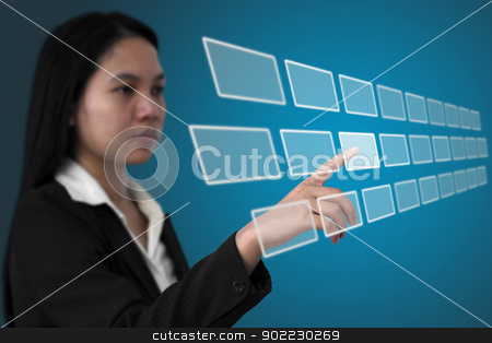 touchscreen interface stock photo, asian business woman touch on touchscreen interface (Selective focus on finger) by Vichaya Kiatying-Angsulee