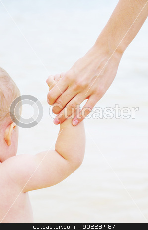 hands stock photo, Baby hand holding mother finger isolated on white by Vitaliy Pakhnyushchyy